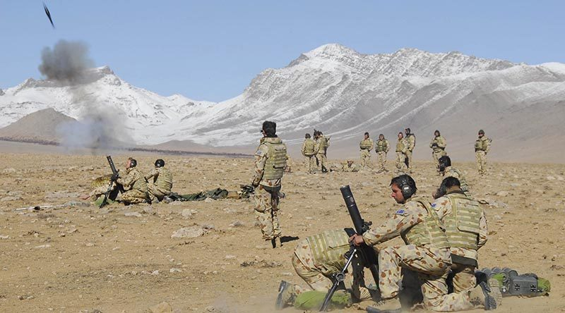 Australian soldiers from Mortar Platoon 2RAR fire a salvo during operations in the Chora Valley, Afghanistan. Photo by Corporal Hamish Paterson.