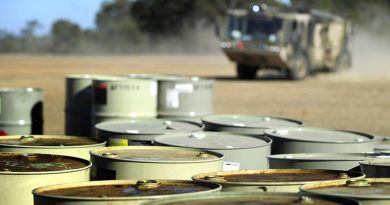 A RAAF Titan fire rescue vehicle responds to a practise fuel drum fire. Photo by Corporal Raymond Vance.