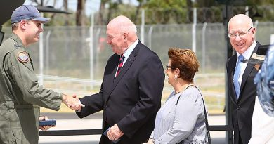 Governor General Sir Peter Cosgrove greets Wing Commander Darren Clare, Commanding Officer No 3 Squadron RAAF, after bring his F-35A Lightning home to Williamtown, NSW. Governor General Cosgrove is flanked by his wife Lyn and Governor of NSW General David Hurley – since named as Sir Peter's successor as Governor General. Photo by Brian Hartigan.