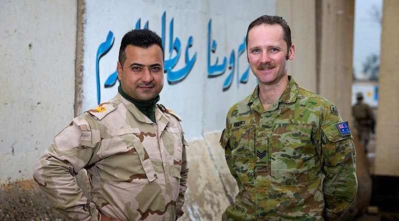 Australian Army linguist Sergeant Mitchel Reeves with Iraqi Army Major Humam at the Taji Military Complex in Iraq. Photo by Corporal Oliver Carter.