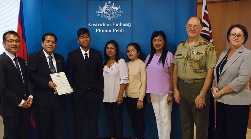 Cambodian interpreter Toch Rada with family and colleagues at the Australian Embassy in Phnom Penh.