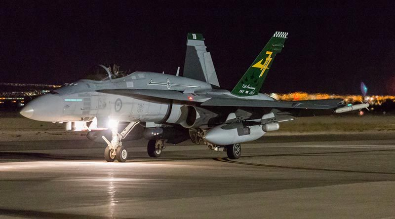 A RAAF Number 77 Squadron F/A-18A Hornet taxies for an Exercise Red Flag 19-1 night mission at Nellis Air Force Base, Nevada. Photo by Corporal David Cotton.