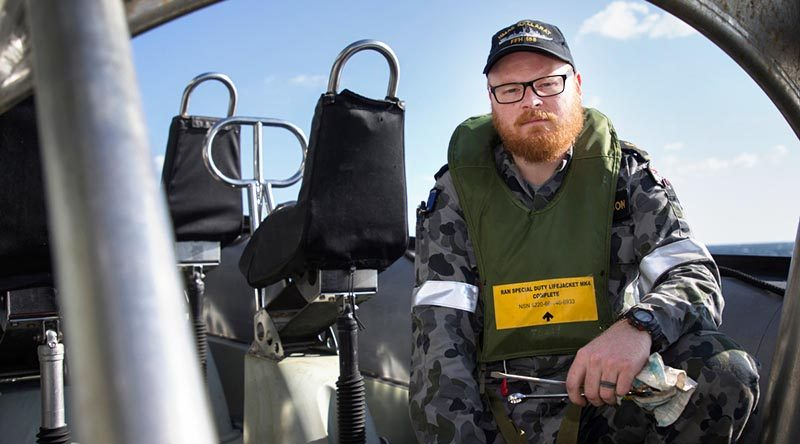 Leading Seaman Daniel Jackson maintains the ship's sea boats as part of his regular duties on board HMAS Ballarat, but has secondary duties that see him employed as a drug-buster. Photo by Leading Seaman Bradley Darvill.