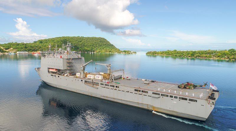 HMAS Choules sails into Port Villa, Vanuatu, during her 2019 month-long Pacific Engagement deployment. Photo by WO2 Mick Davis.