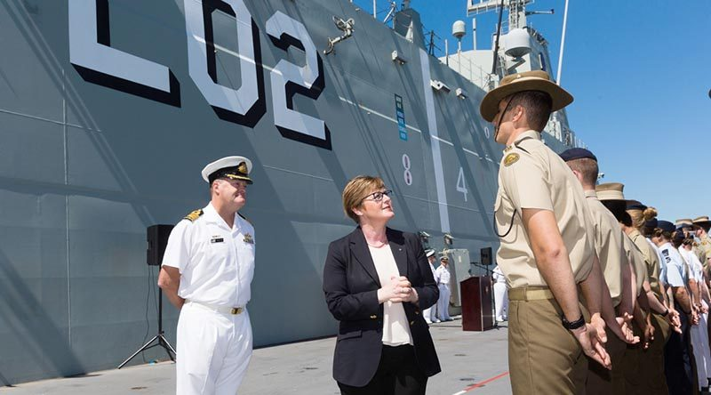 Minister for Defence Industry Linda Reynolds and Commanding Officer HMAS Canberra Captain Ashley Papp inspect members of Joint Task Force 661 before their departure for Indo-Pacific Endeavour 2019. Photo by Leading Seaman Steven Thomson.