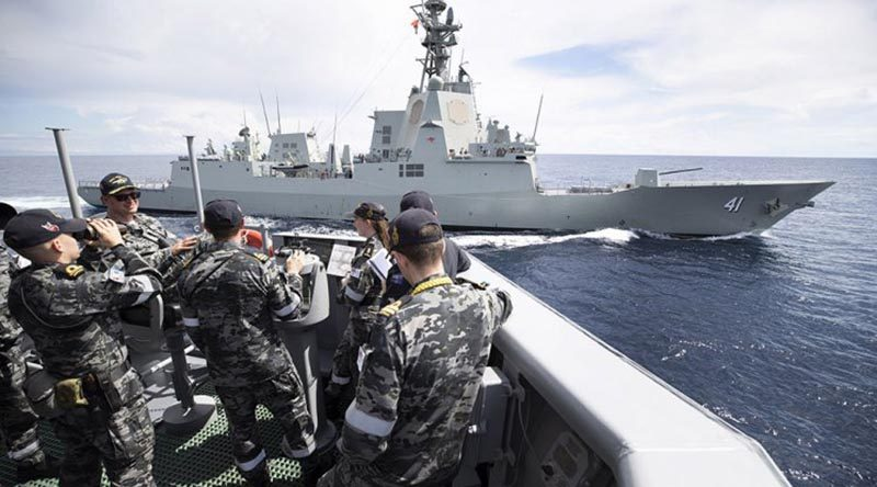 HMAS Melbourne's crew trial the prototype Maritime Multi-cam Pattern Uniform at sea, in company with HMAS Brisbane. Photo by Leading Seaman Kieran Dempsey