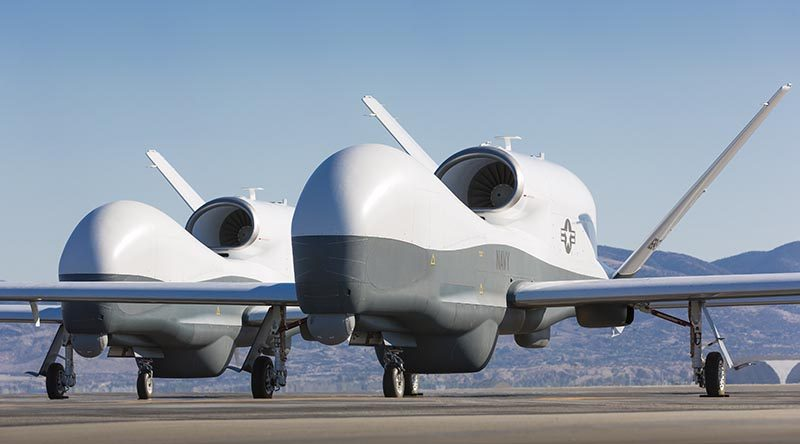 Two Northrop Grumman MQ-4C Tritons at a Northrop Grumman test facility in Palmdale, California. US Navy photo courtesy of Northrop Grumman by Chad Slattery.