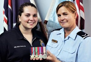 Leading Aircraftwoman (AAFC) Lisa Dibben and former Cadet Flight Sergeant Casey Dibben with the World War 2 medals of Private Geoffrey Whiteman, 6th Australian Division Workshops, AIF.