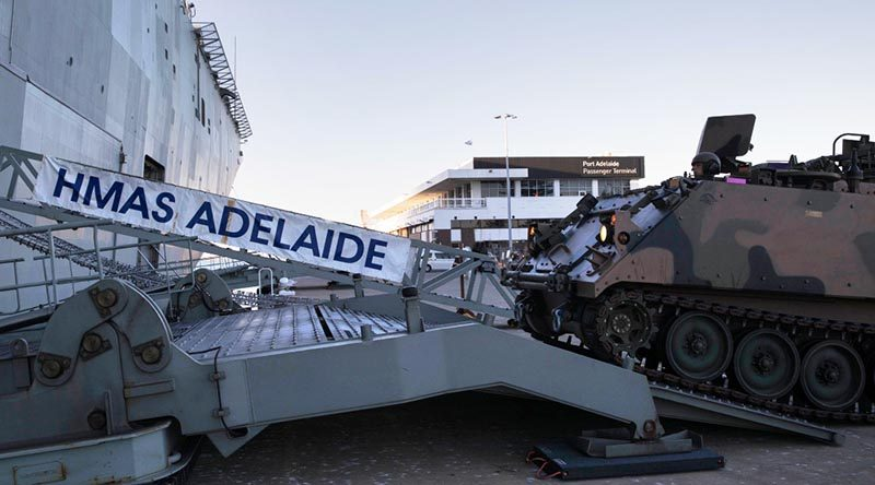Vehicles from the 7th Battalion, Royal Australian Regiment embark HMAS Adelaide as part of an Amphibious Task Group at Port Adelaide, South Australia. Photo by Able Seaman Ryan McKenzie.