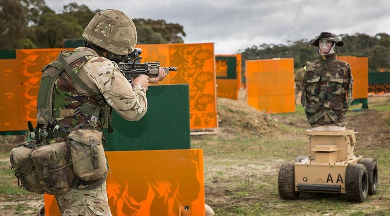 A British Army soldier engages a Marathon Targets robotic target during a close-quarter-engagement match at AASAM 2016. Photo by Sergeant Janine Fabre.