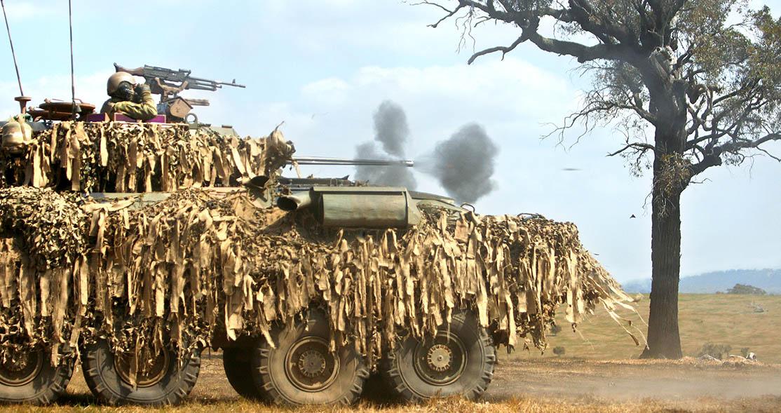 An Australian Light Armoured Vehicle fires its 25mm main gun