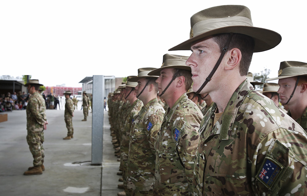 Australian soldiers from Force Protection Element 4 and Force Communication Element 3 on parade at their formal farewell in Brisbane.