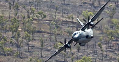 A No 35 Squadron C-27J Spartan flies at low level over Aussie bush.