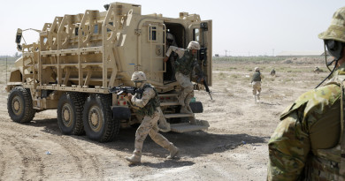 "Australian Army trainer observes an Iraqi soldier dismount from their ""Mine Resistant Ambush Protected (MRAP)"" vehicle during a training exercise at the Taji Military Complex northwest of Baghdad: http://images.defence.gov.au/20150616adf8487947_032.jpg"