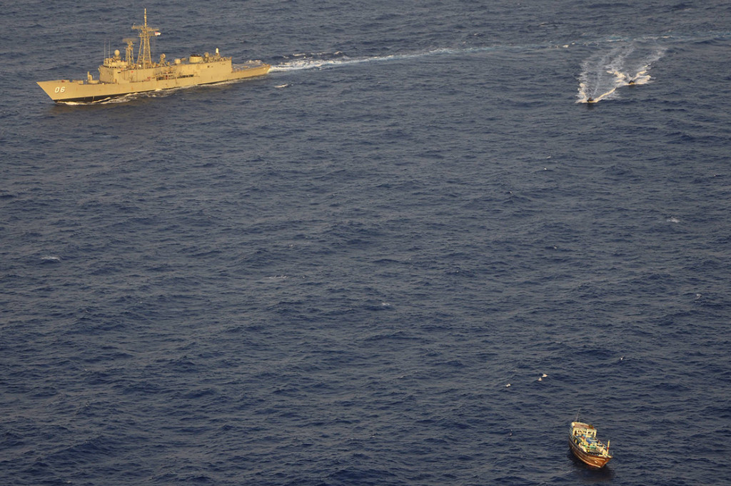 A boarding party from HMAS Newcastle approaches a dhow off the east coast of Africa.