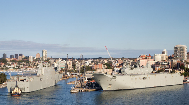 The largest ships ever built for the Royal Australian Navy, Landing Helicopter Dock NUSHIP Adelaide, left, and HMAS Canberra at Fleet Base East, Garden Island, Sydney.
