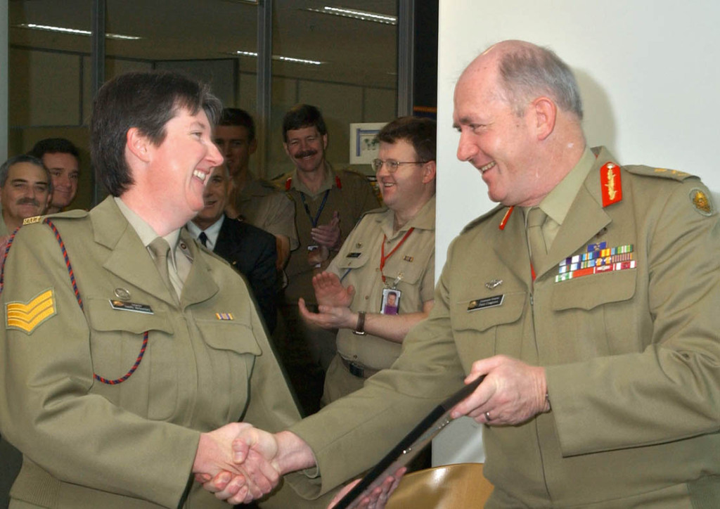 Then Chief of Army Lieutenant General Peter Cosgrove presents a 'safe driving certificate' to Sergeant Sandy McInerney.