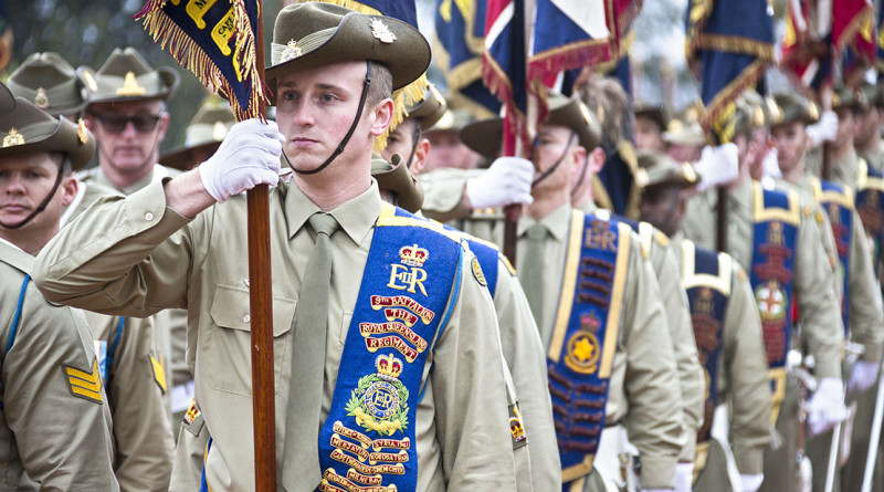Australian Army soldiers carry 2nd Division unit colours, guidons and banners off the parade ground during the centenary parade at the Australian War Memorial, Canberra.