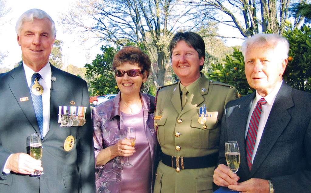 Sergeant Sandy McInerney with her proud parents and then Governor General Michael Jeffery.