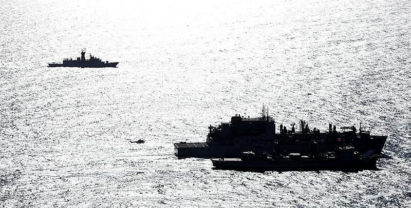 HMA Ships Success and Toowoomba conduct a Replenishment at Sea with United States Navy Ship (USNS) Cesar Chavez, as HMAS Perth stands off on station, while on Operation SOUTHERN INDIAN OCEAN, in search of missing Malaysia Airlines Flight MH370.