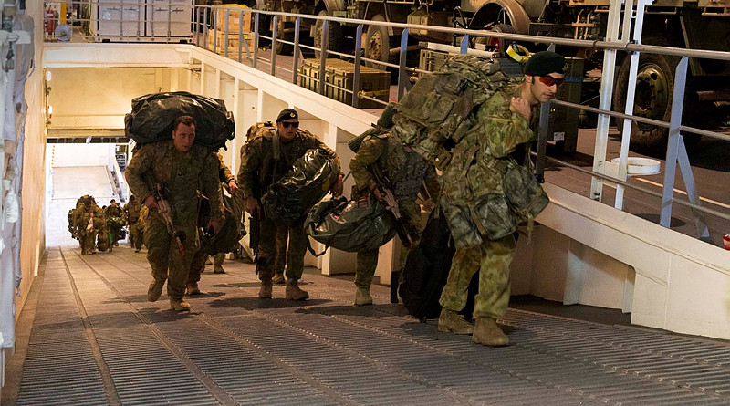 ABOVE: Soldiers from 2RAR embark HMAS Canberra as the ship prepares to sail for Exercise Sea Raider, the last exercise of Sea Series 2015. MAIN: Light Armoured Vehicles from the 2nd Cavalry Regiment drive onboard. Photos by Leading Seaman Helen Frank.