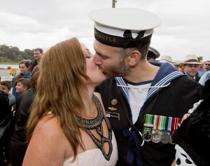 SHE SAID YES! Leading Seaman Warwick Douglas kisses his new fiancée after proposing to her on the wharf of Fleet Base East. Photo by Able Seaman Tom Gibson.