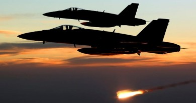 An Australian F/A-18A Hornet relelases a flare at sunset in the skies over Iraq. RAAF photo.