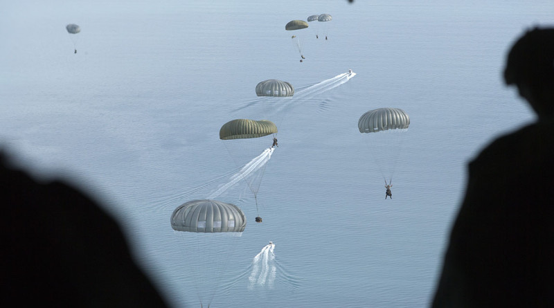 Australian Army Commandos parachute out of a Royal Australian Air Force C-130J Hercules during Exercise Northern Shield 2015.