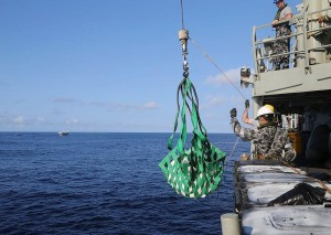 HMAS Melbourne personnel lift seized heroin aboard for processing. Photo by Able Seaman Bonny Gassner