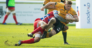 Australian Army Sergeant Scott Ashurst is tackled during the match against the French National Military rugby team at Aldershot. Photo by Corporal Janine Fabre