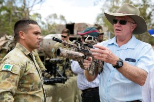 Corporal Kevin Ashby 1RAR explains the characteristics of the new EF88 to former 1RAR soldier Dave Piccinelli.