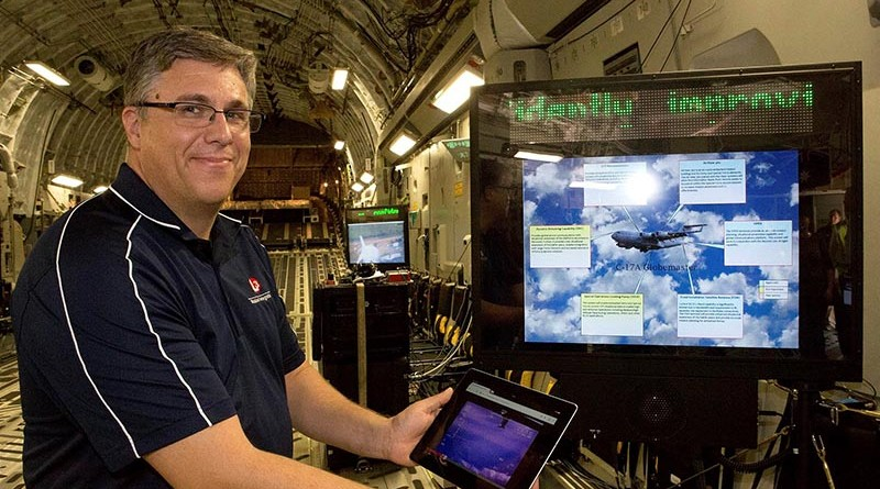 Todd Stibor, L3 Mission Integration, demonstrates wireless connectivity on a C-17A. Photo by Flight Sergeant Kev Berriman .