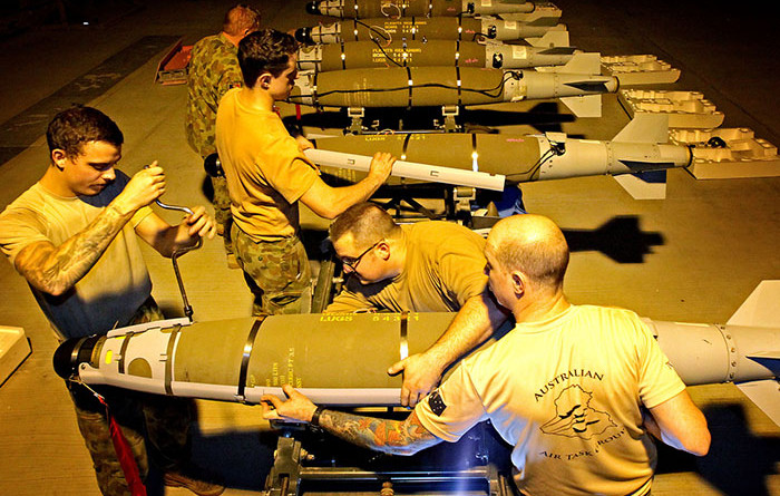 RAAF Aircraft Armament Technicians prepare GBU-54 and GBU-38 bombs for use by the Australian Air Task Group. Photo by Corporal Ben Dempster