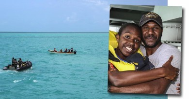 Seaman Edmund Tomsana hugs his sister during an unusual family reunion. Photos by Leading Seaman Sarah Ebsworth