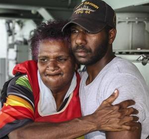 Seaman Edmund Tomsana hugs him Mum.