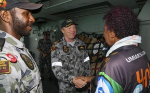 Seaman Edmond Tomsana introduces his mother to Commander Phillip Henry.