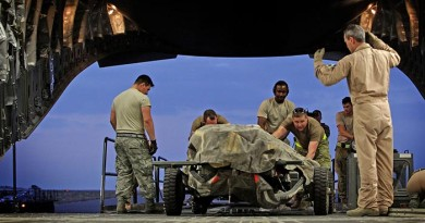 Under direction from a RAAF Loadmaster, American and Australian load team members load military equipment onto a RAAF C-17A Globemaster aircraft in the Middle East Region. Photo by Corporal Ben Dempster