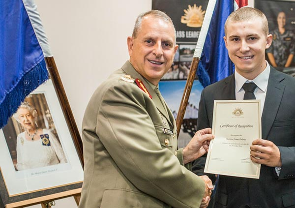 Recruit Harrison Delaney receives his Certificate of Recognition from Major General David Coghlan.