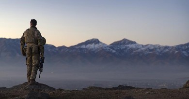 A Danish soldier waits for sunrise on Christmas Eve at the Afghan National Army Officer Academy during a hike to Charandaz peak near Kabul, Afghanistan.