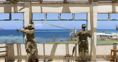 Australian Army Sappers John Corn and Ty Fergus from the 2nd Combat Engineer Regiment, assess a damaged school in the village of Nasau on Koro Island as a part of Operation Fiji Assist.