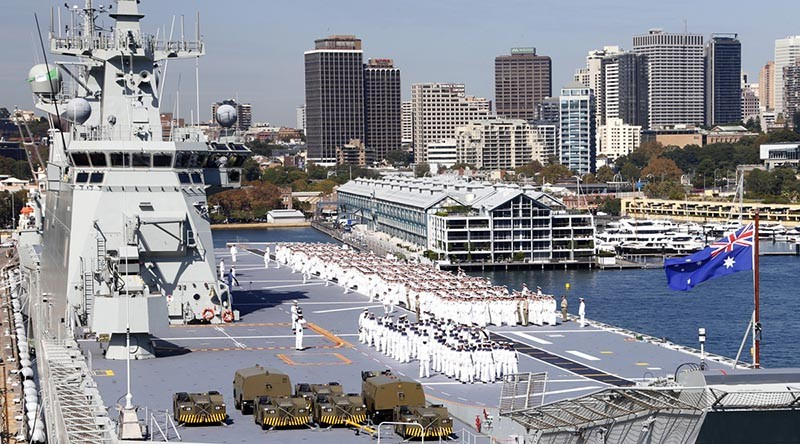 Fleet Divisions on the flight deck of HMAS Adelaide. Photo by Petty Officer Kelvin Hockey