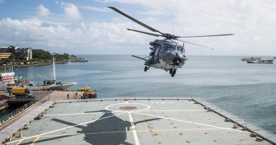 A RNZAF NH90 Helicopter takes off from the flight deck of HMNZS Canterbury whilst along side in Suva Port. The NZDF has deployed to Fiji to provide Humanitarian Aid and Distaster Relief following Tropical Cyclone Winston. NZDF photo