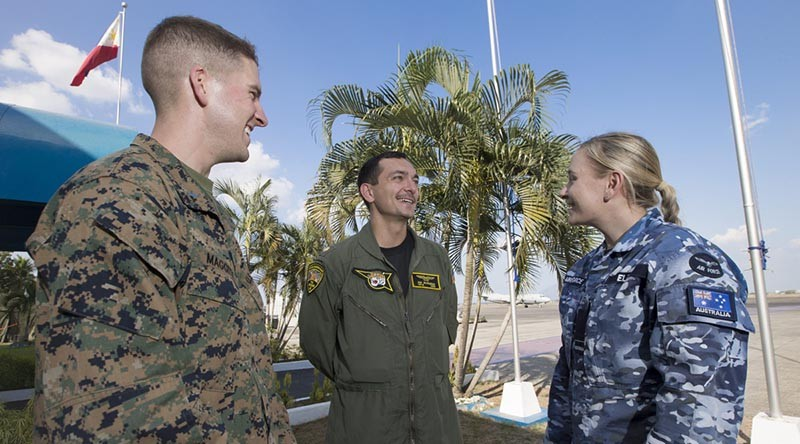 First Lieutenant Michael Maggitti of the United States Marine Corps (left) and Lieutenant Commander Ian Burgess of the United States Navy chat with Flying Officer Danica Ellis of 92 Wing during Exercise Balikatan 2016. Photo by Corporal David Said