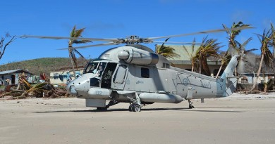 An SH-2G(NZ) Seasprite helicopters assisting with cyclone-recovery operations in Fiji.