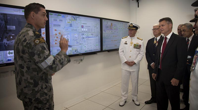 Leading Seaman Maritime Technician Nathan Cook briefs Chief of Navy, Vice Admiral Tim Barrett and the Matt Thistlethwaite MP. Photo by Able Seaman Bonnie Gassner.