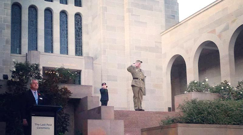 Drew Douglas salutes during The Last Post Ceremony at the Australian War Memorial