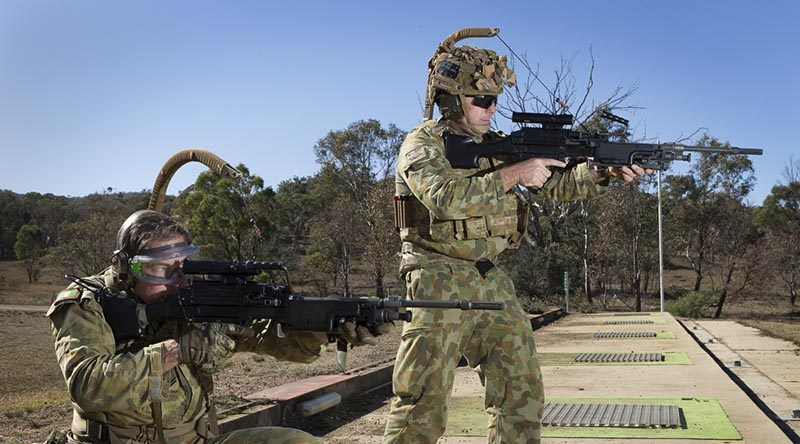 Corporal Paul Hayes (left), 6RAR, and Warrant Officer Class Two Nick Crosbie, 7RAR, trial the new Reaper weapon carriage system. Photo by Sergeant Janine Fabre.