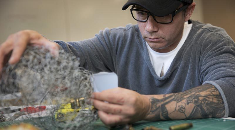 Australian Army soldier Lance Corporal Ty Tranter works on his wire-mesh sculpture during the ADF Arts for Recovery, Resilience, Teamwork and Skills program at the University of Canberra on 18 May 2016.