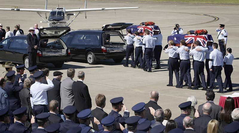Onlookers pay respects as two caskets are carried to waiting hearses during the repatriation of two Australian servicemen missing from the Vietnam War. Flying Officer Michael Herbert and Pilot Officer Robert Carver failed to return from a routine bombing mission on 3 November 1970. They were recovered in thick jungle in an rugged, remote and sparsely populated area of Quang Nam Province, Vietnam, near the Laotian border, and repatriated to Australia in 2009. Photo by Leading Aircraftwoman Amanda Campbell.