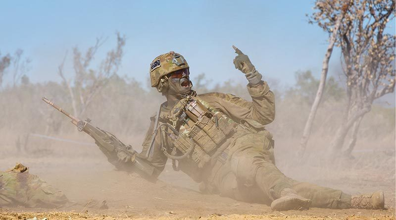 A 2RAR soldier orders his section to advance during a platoon attack, at Bradshaw Field Training Area, Northern Territory, during Exercise Talisman Sabre 2015. Photo by Lance Corporal Kyle Genner